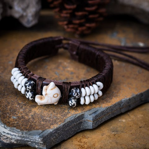 Faux Ivory Dolphin Leather Bracelet in Brown