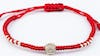 Braided Waxed String Bracelet with Silver Flower Charm in Red