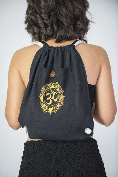 Ohm Drawstring Cotton Canvas Backpack in Gold on Black